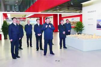 """习近平总书记在河北雄安新区规划展示中心通过大屏连线公司参与监理的雄安城际铁路建设者,称赞他们是""""千年"""